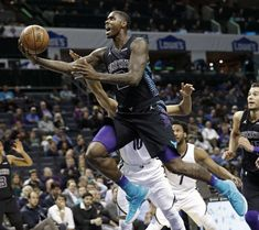 Slide 27 of 75: Charlotte Hornets' Marvin Williams, front, drives past Memphis Grizzlies' Ivan Rabb during the first half of an NBA basketball game in Charlotte, N.C., Thursday, March 22, 2018. (AP Photo/Chuck Burton)
