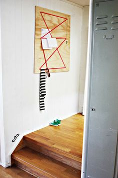 Elastic and Plywood Organizer.  Great idea for cork board, too.