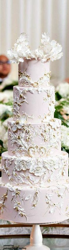 "beautifully ""painted"" wedding cake.  work of art. pink, white, and gold."