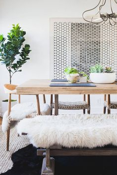 Black & White ~ White Fur Covered Chairs, Black Fur Rug over Sisal type Rug, Accents in White, Gray & Silver