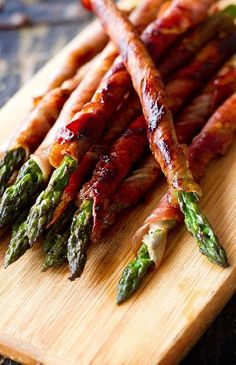 We love our springtime veggies --- peas, artichokes, sugar snap peas, you name it. But we have a special fondness for the bright green bundles of asparagus popping up in our local farmers' markets. The slender stalks (full of folate, fiber and vitamins A and K, we might add!) are great for crunch-ifying salads, and when blended up with some sweet peas and celery, they make a skinny summer soup that's pretty bomb [dot] com. But guess what? We discovered 15 more delicious ways to cook up the…