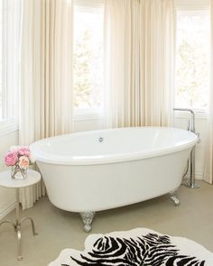 This is such a stunning bathroom, designed with our elegant Balneo Cella bathtub. We love it! Lear all about this tub here : http://www.bainultra.com/therapeutic-baths/our-collections/balneo/cella-6636