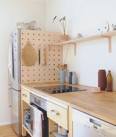 12 Favorites: Pegboard Storage Organizers - The Organized Home - A DIY wooden pegboard in the kitchen of illustrator/graphic designer Swantje Hindrichsen creates use - Wooden Pegboard, Diy Kitchen Storage, Kitchen Remodel, Kitchen Decor, Home Remodeling, Home Decor, New Kitchen, Home Kitchens, Diy Kitchen