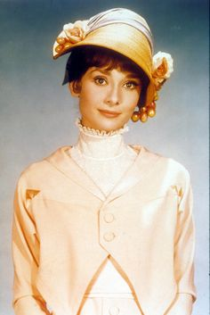 Audrey Hepburn looking adorable. Only Audrey can make a cloche hat with what looks like hanging pearl grapes look good.