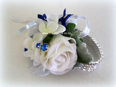 Blue and white wrist corsage on silver diamante bracelet image Home Decor Floral Arrangements, Promposal, Wrist Corsage, Blue Crystals, Stretch Bracelets, Artificial Flowers, Silk Flowers, Shades Of Blue, Wedding Flowers