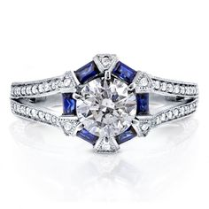Art deco engagement ring with diamonds and blue sapphires. Fourteen karat white gold bridal jewelry.