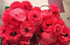 Make a simple poppy for Memorial Day using red tissue paper and construction paper.