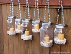 Hanging Mason Jar Garden Lights -I think combining this with the DIY custom mason jars would create a nice and unique space! Mason Jar Candle Holders, Mason Jar Lanterns, Hanging Mason Jars, Mason Jar Lighting, Diy Hanging, Candle Jars, Hanging Candles, Glass Jars, Hanging Lights