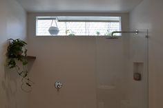 High window in shower. Floating wooden (Tasmanian Blackwood) shelf
