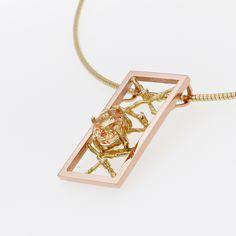 Red and Yellow golden pendant with orange/yellow sapphire and diamonds.Contemporary dutch design. Handmade by Sabine Eekels. Rood en geelgouden hanger met oranje/gele saffier en diamantjes