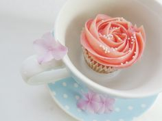 Cupcake in a cup! Pastel colors, pink, blue.