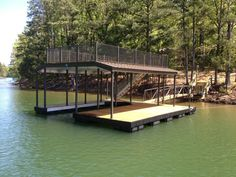 Casey Custom Docks Completes Wahoo CAT 5 Aluminum Floating Boat Dock with Sun Deck on Lake Allatoona: This two level floating aluminum boat dock features an 800-sq. ft sun deck with burnished slate roof and antique bronze rails. The underside is protected by DryJoist decking from Wahoo Decks. The dock and the 40-foot aluminum gangway are both covered in ironwood decking.  The dock is secured in place by the cable to shore anchoring method.