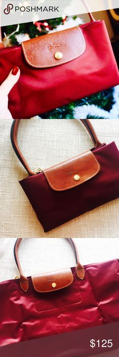 "Brand new Longchamp Le Pliage large tote Brand new never used Longchamp Le Pliage large size tote in beautiful wine red. One of the prettiest color. Dimensions:  12 ¼""W x 11 ¾""H x 7 ½""D. (Interior capacity: large.) 9"" strap drop. Longchamp Bags Totes"