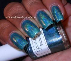 Enchanted Waterfall is a teal super holographic opaque polish!Swatches are by Babi from colorsutraa.blogspot.com and ColorSutraa on Facebook. Swatch is three coats. All items are handmade, therefore individual variations can occur between batches. Color may vary due to the monitor that your are using to view the product.Variations in application technique and thickness can alter your particular outcome. Please note I use a variety of bloggers/artists who all use ...