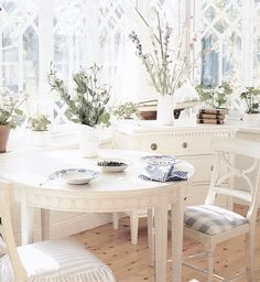 Pretty display of a reproduction Carl Larsson table and Gustavian chairs.