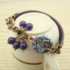 Purple leather bracelet, ceramic floral link, mixed metals copper brass, amethyst beads by laurelmoonjewelry, $24.00