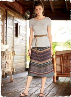 The mid-length A-line skirt is jacquard knit in mitered stripes of sun-faded blush, almond, twilight, teal and raspberry pima.