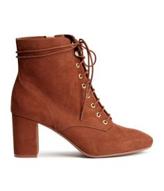 Rust brown. Lace-up boots in imitation suede with a zip at side and covered heels. Satin lining, imitation leather insoles, and rubber soles. Heel height 3