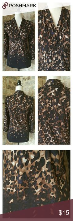 Liz Claiborne Animal Print Top Nice Liz Claiborne top in an animal print in beige, tan, brown and black with a tiny bit of navy. Top has a criss cross bodice and 3/4 length sleeves. 95% polyester and 5% spandex. Excellent condition. EUC Liz Claiborne Tops