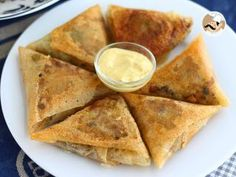by PetitChef_Official Indian Snacks, Indian Food Recipes, Asian Recipes, Ethnic Recipes, Samosas, Easy Samosa Recipes, Tapas, My Favorite Food, Favorite Recipes