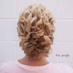 Mother of the bride hairstyle. Curly blonde updo.