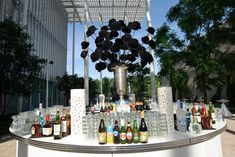 """Art Institute of Chicago's Woman's Board and Board of Trustees """"Surrealistically Chic"""" Gala  The museum hosted a gala celebrating the surrealist artist Magritte in June. A cocktail reception was held in the museum's garden. HMR Designs brought in a round central bar with a huge centerpiece of bowler hats, which paid tribute to the Belgian artist.  Photo: Cheri Eisenberg"""