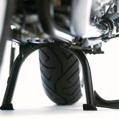 Triumph Bonneville/SE Center Stand Kit A9758145  Make maintenance easy with the center stand kit from Triumph. High quality construction. Includes all necessary mounting hardware. This center stand allows you to raise the tires off the ground to adjust the chain. This center stand allows you to raise the tires off the ground to adjust the chain. Black powder coat finish. This center stand allows you to raise the tires off the ground to adjust the chain. This center stand allows you t..