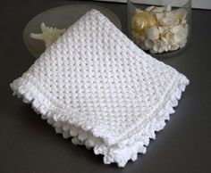 Chinese Wave Knit Washcloth Pattern, suggested materials and instructions for a hand knit washcloth with crocheted picot edging. Perfect for your own home or gift giving.