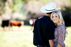 Rustic Western Engagement Pictures but maybe with horses in the back ground
