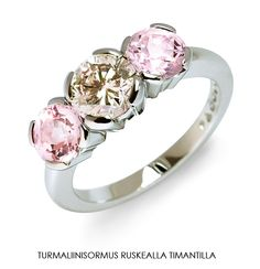 Pink tourmalines and a brown diamond. Atelier T. Tillander
