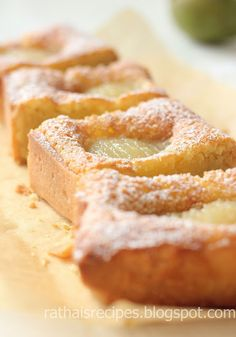 A delicious pear frangipane tart, consisting of a crispy tart shell, succulent almond filling and poached pear halves.