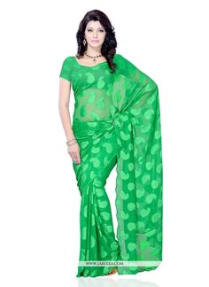 This brilliant array will make you the ultimate classic beauty at the next event you attend. Make the heads turn when you dress up in this charming green jacquard casual saree. This attire is showing ...
