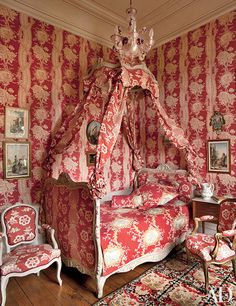 In the Polish bedroom at Château de Jozerand, Pierre Frey fabrics—some matching, others complementary—add stripes and blooms to walls and upholstery. The 15th-century residence, located in France's Auvergne region and remodeled in the 19th century, is the country residence of artist Joy de Rohan-Chabot and her husband, Count Jean de Rohan-Chabot. | archdigest.com
