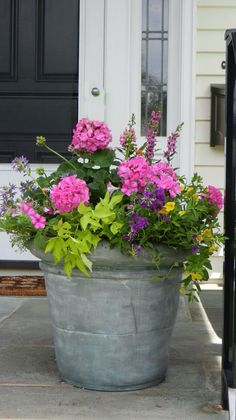 summer planter – I think the light & dark leaves add interest, and I've always loved the pink/purple combo. summer planter – I think the light & dark leaves add interest, and I've always loved the pink/purple combo. Container Flowers, Flower Planters, Garden Planters, Flower Pots, Porch Planter, Full Sun Planters, Geranium Planters, Full Sun Container Plants, Potted Plants Patio