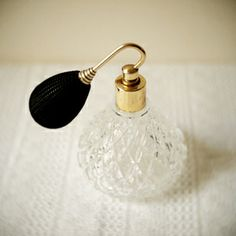 I have always secretly longed for a perfume bottle like this...with the little puff thingy on the end.