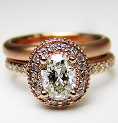 Rose gold with oval diamond. I would totally wear this!! So stunning! The cut is surprisingly beautiful considering I'm not a fan of oval stones