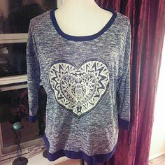 Beautiful soft blue heart shirt. NWT Blue and cream shirt with blue band at bottom and around neck. Pretty heart in center. From shoulder to hem 25 in. From underarm to underarm 23 in. Underarm to end of sleeve is 12 in. Absolutely Famous  Tops Blouses