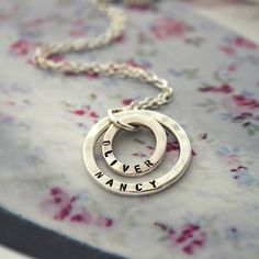 Carry your loved one close to your heart at all times with the beautiful Personalised Mummy And Baby Necklace. Two sleek sterling silver ring pendants are suspended from a fine sterling silver chain, ready for your choice of unique personalisation. The smaller ring fits inside the larger ring pendant, symbolising the eternal bond between mother and child. For a truly special touch this design can be plated in 9ct rose or 9ct yellow gold. The Personalised Mummy And Baby Necklace makes a…