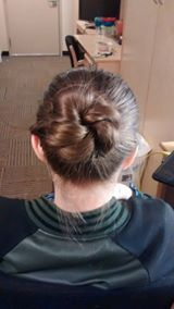 Back view. I did a rope braid and turned into a bun. ---->