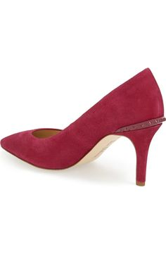 The spike detail on the back of these pink suede pumps adds the perfect hint of edge to these feminine heels.