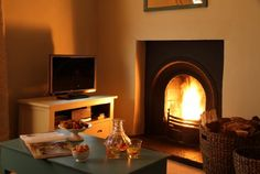 Curl up by the log fire in the sitting room