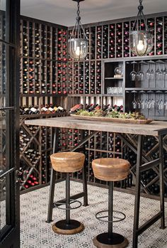 Beautiful Industrial-farmhouse wine room with patterned tile. The patterned tile is Mediterranean 26 tile from Tabarka Studio. Barstools are Caymus Bar Stools from Arteriors. Pendants are Clifton Pendant from Currey and Company. Table is custom made. Wine Rack Design, Wine Cellar Design, Wine Cellar Modern, Bodega Bar, Wine Rack Furniture, Bar Furniture, Wine Cellar Basement, Home Wine Cellars, Wine Tasting Room