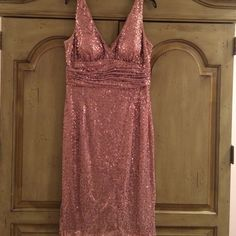 Sequin cocktail dress Beautiful Rose gold sequin cocktail dress. V neckline and v back with ruching at  waist. Back hidden zipper.  Knee length. Worn once. Make an offer!! Price is flexible Eliza J Dresses Midi
