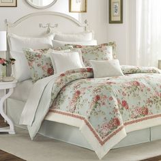 Laura Ashley's floral designs are always inspired by the beauty of English gardens and Vivienne is the newest expression of that clasic inspiration. Pink and white roses and dahlias are lavishly strew                                                                                                                                                                                 More