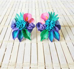 Vintage Poly Clay Earrings, Tropical Flowers, Clip on, Jewel Tones, Big Statement earrings, 1980's, Carmen Miranda style, Teal & Purple by RetroRevivalBoutique on Etsy https://www.etsy.com/listing/489372905/vintage-poly-clay-earrings-tropical