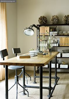 When we get a house, we want to make a table like this, but with unpainted galvanized pipes instead, and an ash stain for the wood.  Can't wait!!