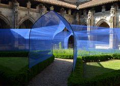 Atelier Yokyok installs vaulted string tunnels in cloister garden