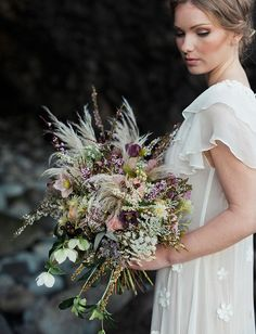 whimsical boho bouquet with grasses queen anne's lace hellebores