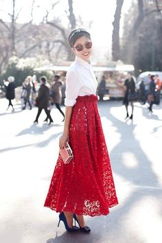 long red lace a-line skirt paired with a crisp white blouse & red sunglasses