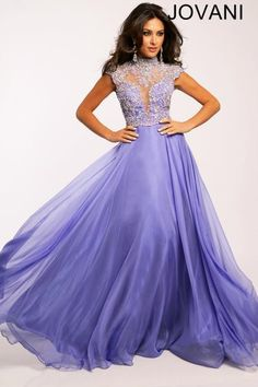 Channel timeless grace in this full-length lavender evening gown. Flowing A-line skirt with layers of purple meets a royal top. Plunging sweetheart neckline overlaid with sheer and crystal details up